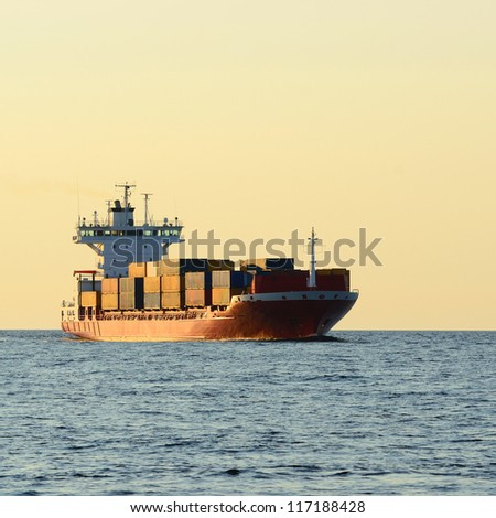 cargo container ship sailing in still water