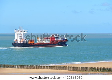 Cargo container ship sailing in the sea by the coast of Vlissingen, the Netherlands - stock photo
