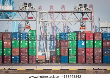 Cargo containers waiting for transport - stock photo