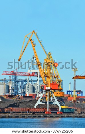 Cargo crane freight train and coal in port - stock photo