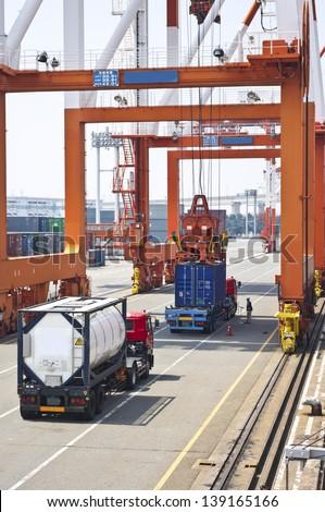 Cargo crane operation in port - stock photo