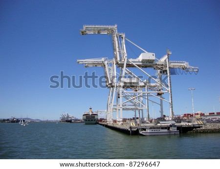 Cargo Cranes in Oakland Harbor on a nice day. - stock photo