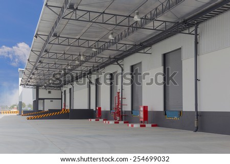 cargo doors at big warehouse with fire Equipment - stock photo