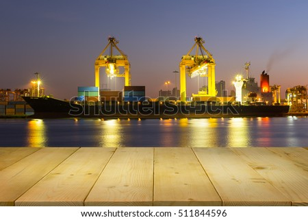 Cargo freight ship and cargo container working with crane at port, twilight time.