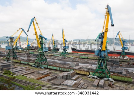 Cargo handling of metal on a ship in port of Nakhodka, Russia. - stock photo