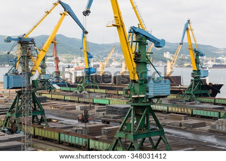 Cargo handling of metal on ship in port of Nakhodka, Russia. - stock photo