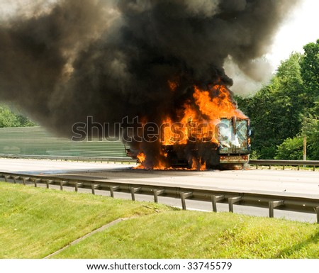 cargo loss in track engulfed by fire with black smoke - stock photo