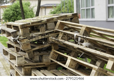 Cargo pallets stacked in the park. - stock photo