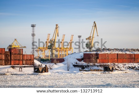 Cargo port in winter. Containers poles and cranes. St.Petersburg, Russia - stock photo