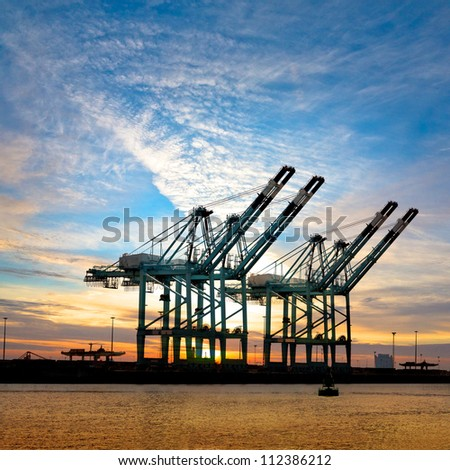 Cargo sea port. Sea cargo cranes. Sea. Sunset. - stock photo