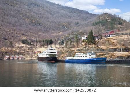 Cargo ship anchored near the shore in the bay - stock photo