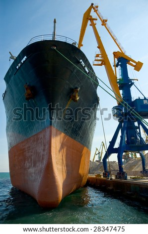 Cargo ship at berth under loading operations