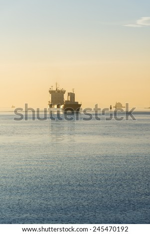 Cargo ship at sunset in the Oslo fjord, Norway - stock photo