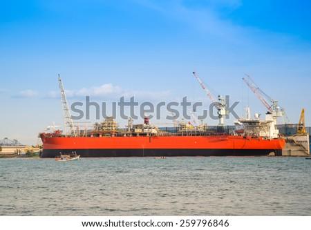 Cargo ship (Bulk carrier) loading in cargo terminal of Thailand - stock photo