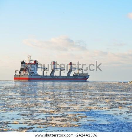 Cargo ship (Bulk carrier) sailing. Riga, Latvia - stock photo