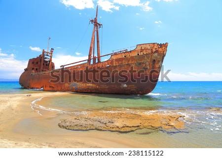 Cargo ship covered with rust on a beach near Gythio, Greece - stock photo