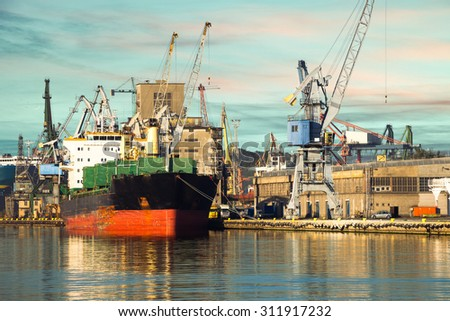 Cargo ship in the morning light on port of Gdansk, Poland. - stock photo