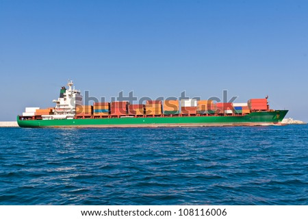 Cargo Ship Leaving the Port - stock photo