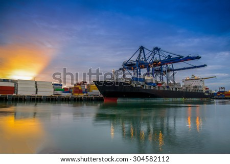 Cargo ship loading containers by crane in the morning , Trade Port , Shipping - stock photo