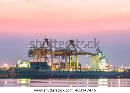 Cargo ship loading containers by crane , Trade Port , Shipping - stock photo