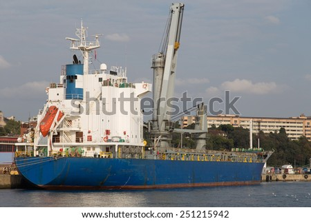 Cargo ship loading in a trading port