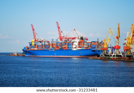 Cargo ship on loading in the port - stock photo