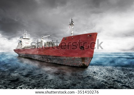 Cargo Ship on the sea with dramatic sky during in winter. - stock photo