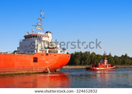 Cargo ship out of the port of Gdansk, Poland. - stock photo