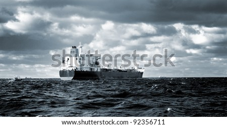 cargo ship sailing in stormy weather near port of Riga - stock photo