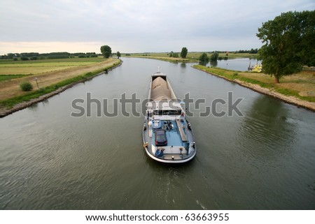 Cargo ship shipping gravel on the IJssel river in The Netherlands - stock photo