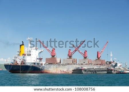 cargo ship with crane - stock photo