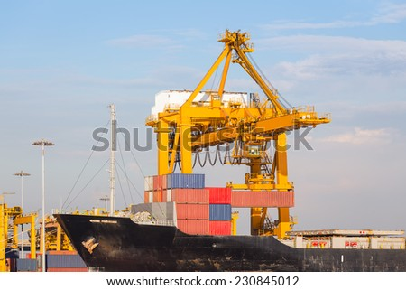 Cargo ship working with crane at port. - stock photo