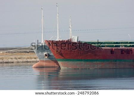 Cargo Ships in Container Terminal - stock photo
