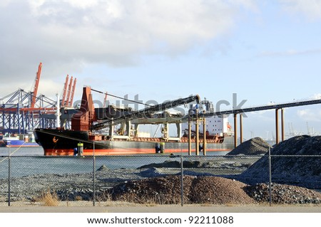 cargo ships in the harbor of rotterdam netherlands - stock photo
