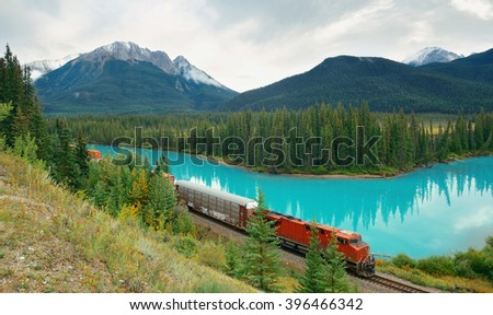 Cargo train and lake forest in Banff National Park in Canada - stock photo