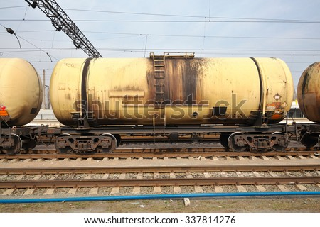 Cargo train with oil cars on the railway station - stock photo
