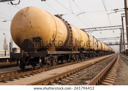 Cargo train with oil tanker cars on the freight station