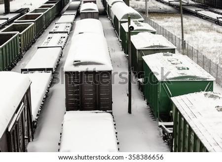 Cargo trains in winter - stock photo