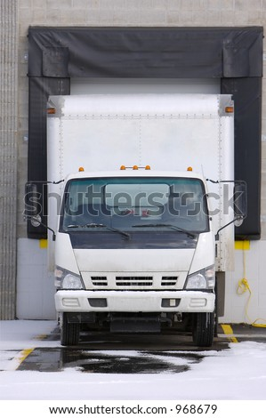 Cargo Truck Loading or Unloading at Docking Bay - stock photo