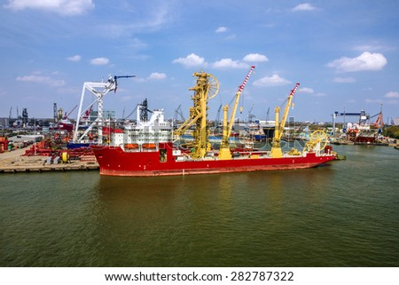 Cargo vessel in sea port Rotterdam, Netherlands. - stock photo