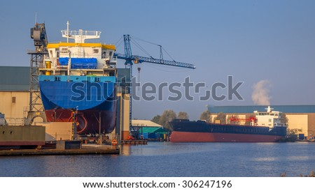 Cargo vessels being Constructed on a small Wharf in the Netherlands - stock photo