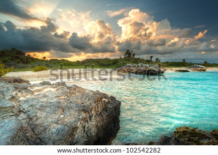 Caribbean beach in Mexico at sunset