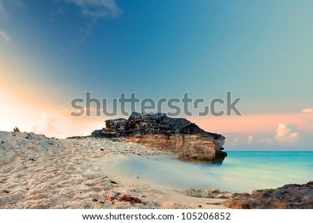 Caribbean beach in Mexico at sunset - stock photo