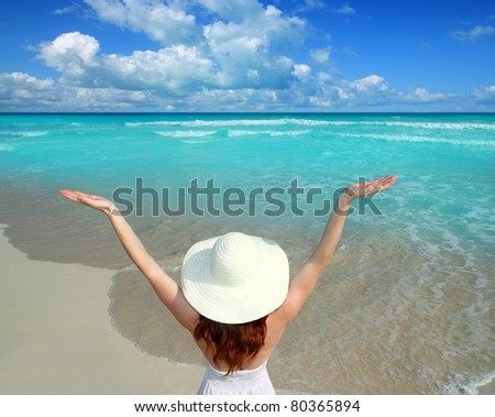 Caribbean beach woman rear view spending happy vacation with open arms gesture - stock photo