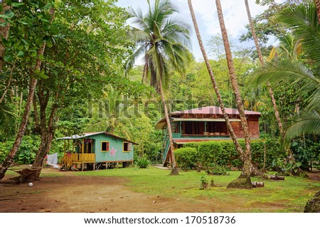 Caribbean house and hut with tropical vegetation, Gandoca Manzanillo national wildlife refuge, Limon, Costa Rica - stock photo