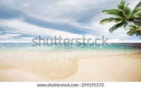 Caribbean ocean and tropical beach summer island - stock photo