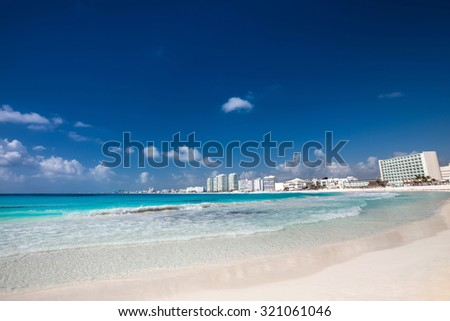 Caribbean sandy beach with turquoise water   - stock photo