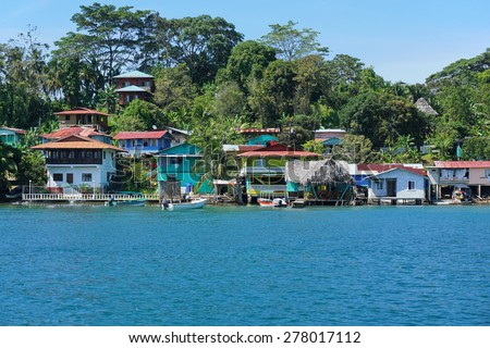 Caribbean village of Old Bank with tropical vegetation on the coast of Bastimentos island, Bocas del Toro, Panama - stock photo
