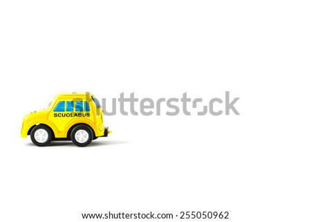 Caricature of a school bus. Little toy caro f a Italian school bus - stock photo