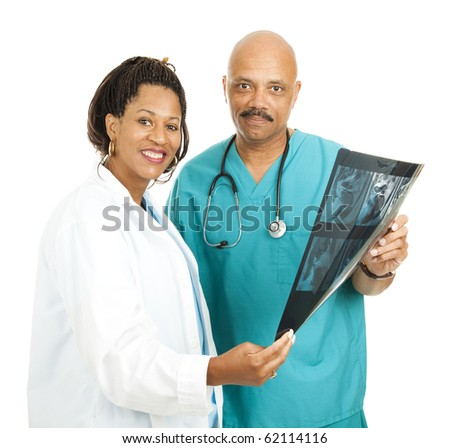 Caring, compassionate African American medical doctors.  Isolated on white. - stock photo
